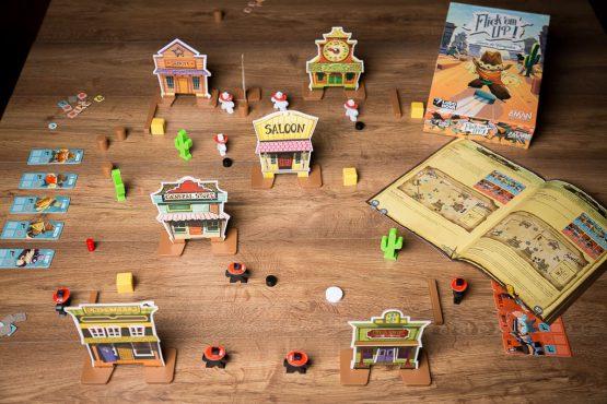 Foto van de spelonderdelen van het bordspel Flick 'em Up Plastic versie