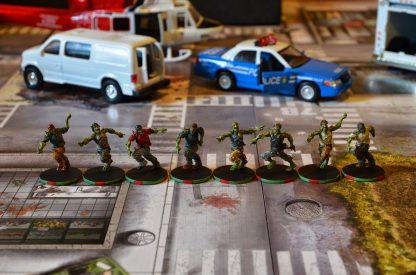 Afbeelding 2 van een moment gedurende het bordspel Zombicide Toxic City Mall